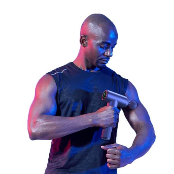 Male Model Using Massage Gun Super Pro
