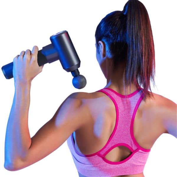 Female Model Using Massage Gun Super Pro On Her Back
