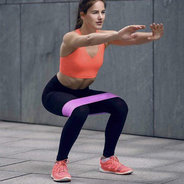 Women using botthms yoga resistance bands
